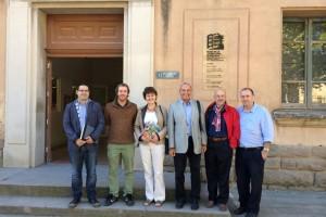 Una delegació d'una colònia escocesa i estudiants universitaris visiten les colònies tèxtils